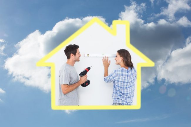 Cheerful man and his wife doing home improvements together against cloudy sky